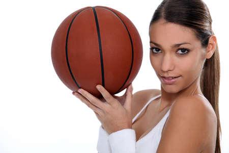 woman playing basketball photo