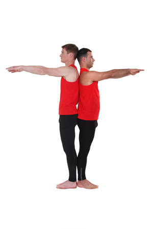 Male gymnasts back to back photo