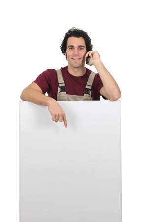 Artisan pointing white panel Stock Photo - 13713774