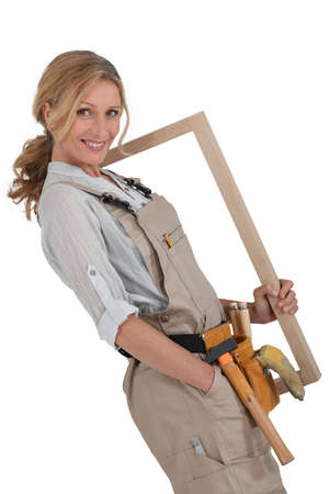 40 45: Woman carpenter Stock Photo