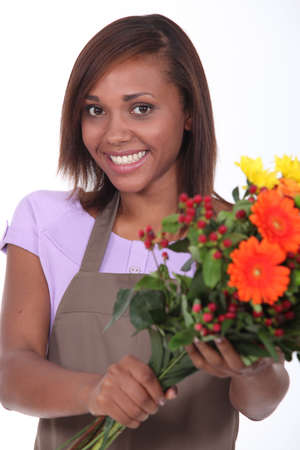 Young florist with a bunch of flowers photo