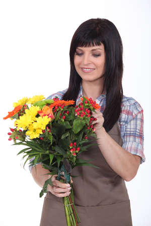 Florist preparing bouquet photo