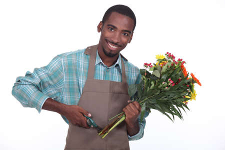 Male florist with a bunch of flowers photo