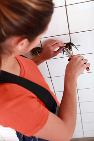 Electrician fixing electrical wiring Stock Photo - 13712772