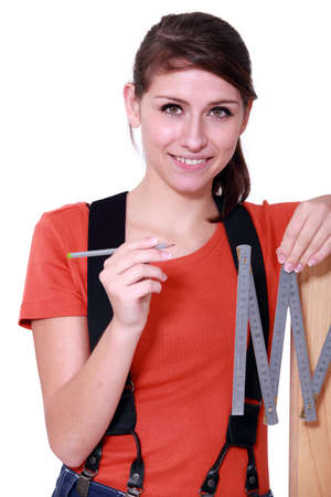 workwoman: Woman using a carpenter