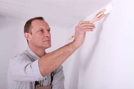 Man repainting home walls photo