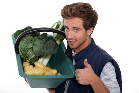 portrait of a gardener with vegetables photo