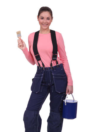 Woman holding a paintbrush and can of paint Stock Photo - 13713678