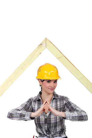 Woman stood by wooden framework photo