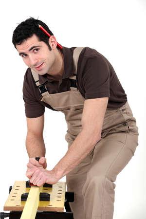 gimmick: Carpenter sanding Stock Photo
