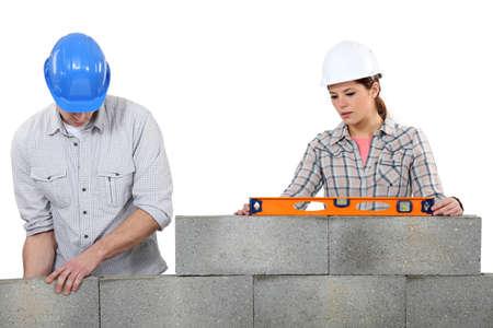 Couple doing masonry  photo