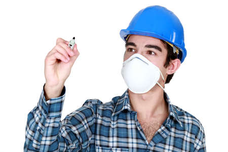 Worker wearing a face mask and holding a felt-tip pen photo