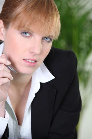 sexy teacher: Businesswoman trying to find inspiration Stock Photo