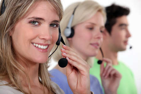 personal service: Woman and colleagues wearing headsets
