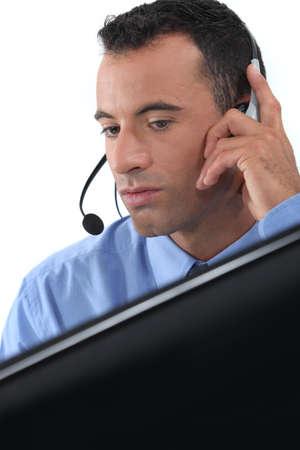 advisement: businessman wearing a headset