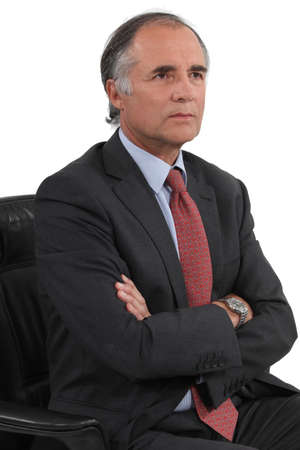 frowning: serious businessman posing
