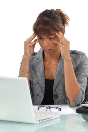 Woman suffering from a headache photo