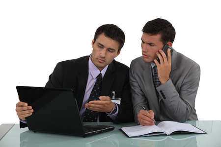 technical service: Businessman working out a problem on a laptop