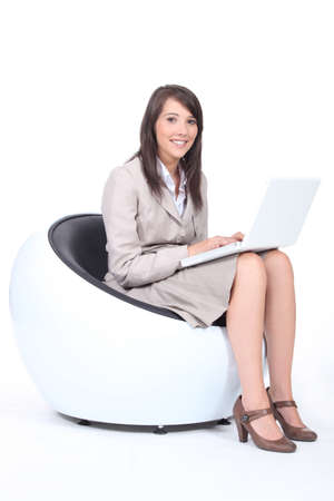 Young woman using a laptop computer Stock Photo - 13713723