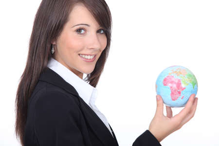 Young businesswoman with the world in her hands photo