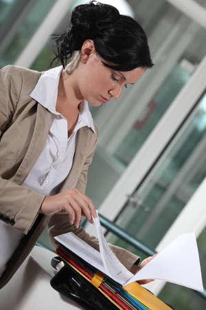 serious businesswoman reading documents photo