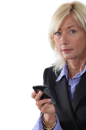 Mature businesswoman with a cellphone photo