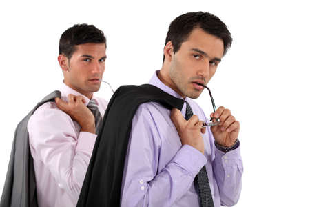 Businessmen with their jackets over their shoulders Stock Photo - 13713498