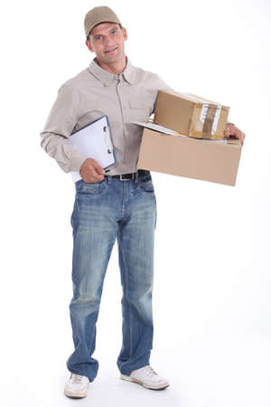 Courier with a clipboard and parcels photo
