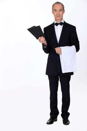 Waiter with menus photo