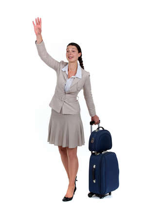 hailing: Woman waving goodbye Stock Photo