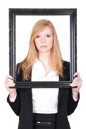 Woman holding up a picture frame Stock Photo - 13712378