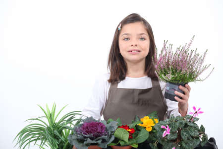 make belief: A little girl posing with her plants