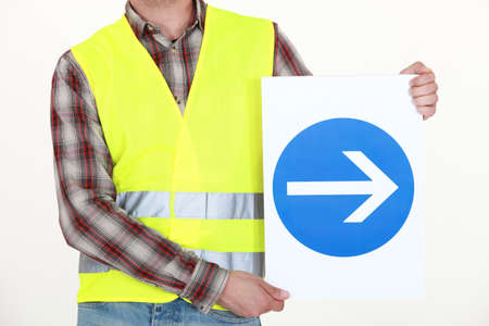 Man holding road sign Stock Photo - 13712384