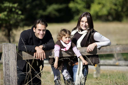 leaning by barrier: Family enjoying a walk in the countryside