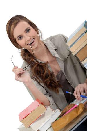 homestudy: Happy student doing homework