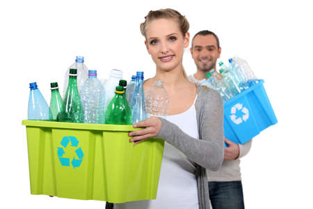 carry out: Couple taking out the recycling