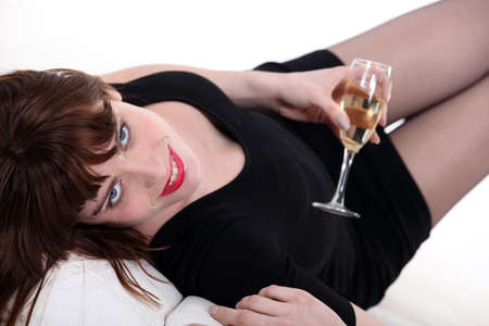 lbd: Woman in a little black dress with a glass of champagne Stock Photo