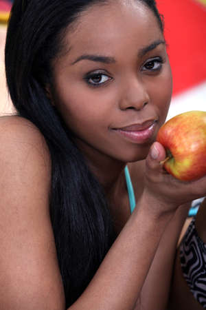 gorgeous black woman eating apple photo