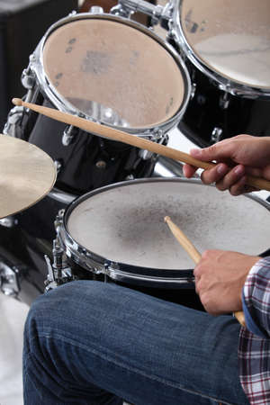 snare: man playing drums