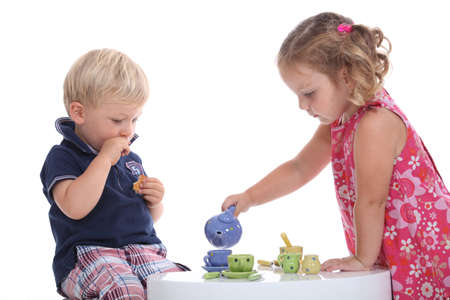 stand teapot: kids at tea party