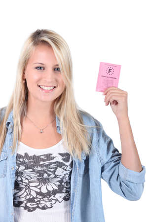 girl with driving license Stock Photo - 13712068