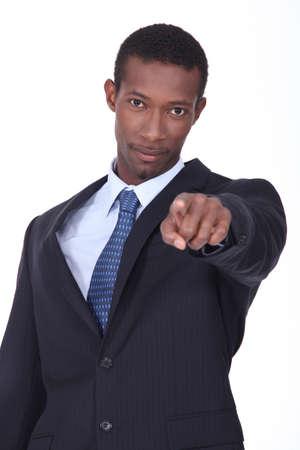 left handed: Man pointing forward