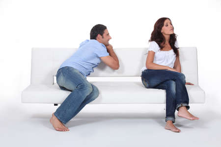 stance: Man apolgising to woman on couch