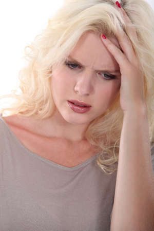Troubled blonde woman holding her head in her hands Stock Photo - 13712171