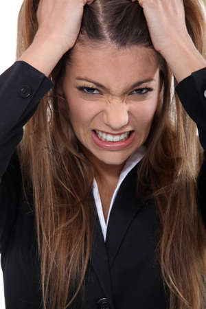 enraged: Businesswoman pulling hair out