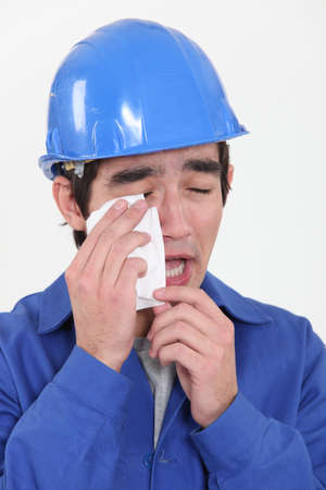Construction worker crying photo