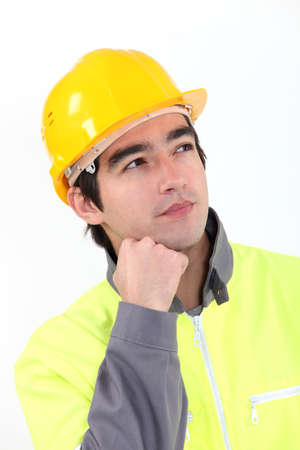 A pensive manual worker  photo
