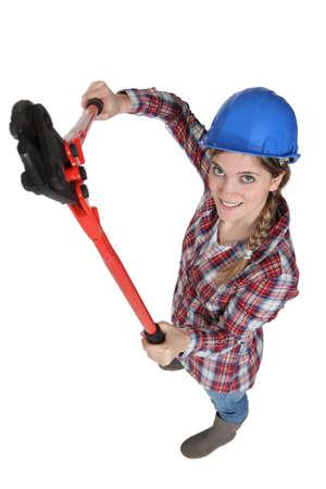 servicewoman: craftswoman holding a huge spanner