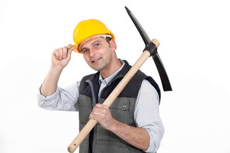 ax man: Man with ax tipping helmet Stock Photo