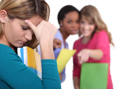 mean: Female student being bullied Stock Photo